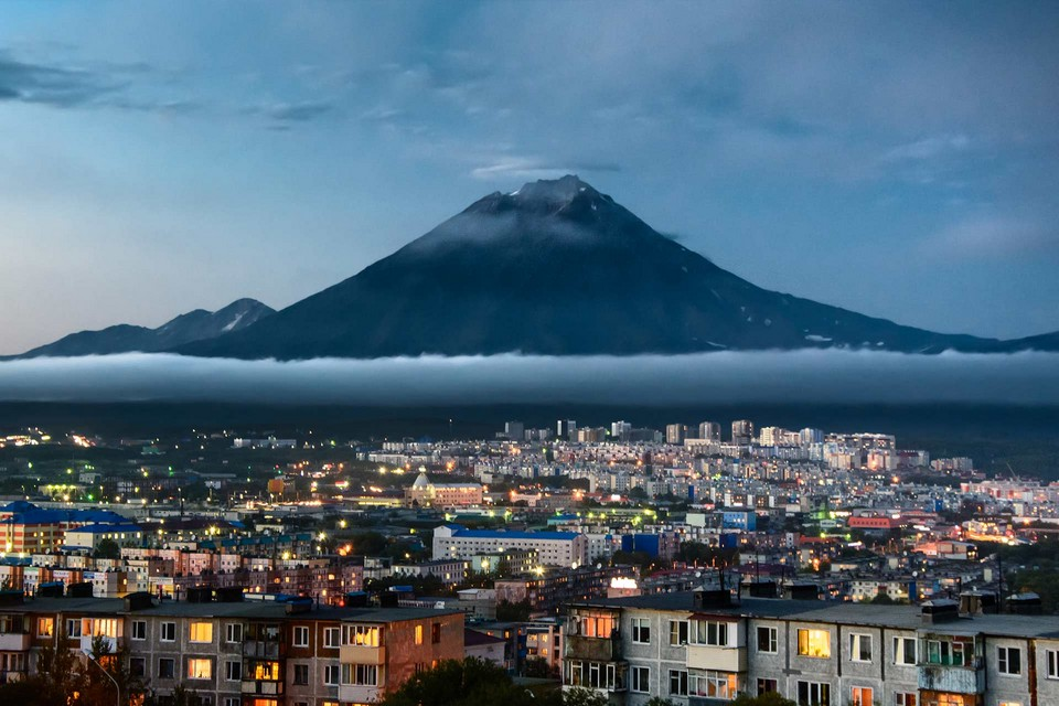 Russian city at the bottom of a volcano in the evening