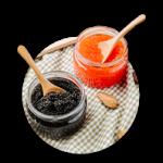 Two jars with caviar, black sturgeon caviar and red salmon caviar