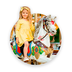 A cute girl riding a toy horse, amusement ride