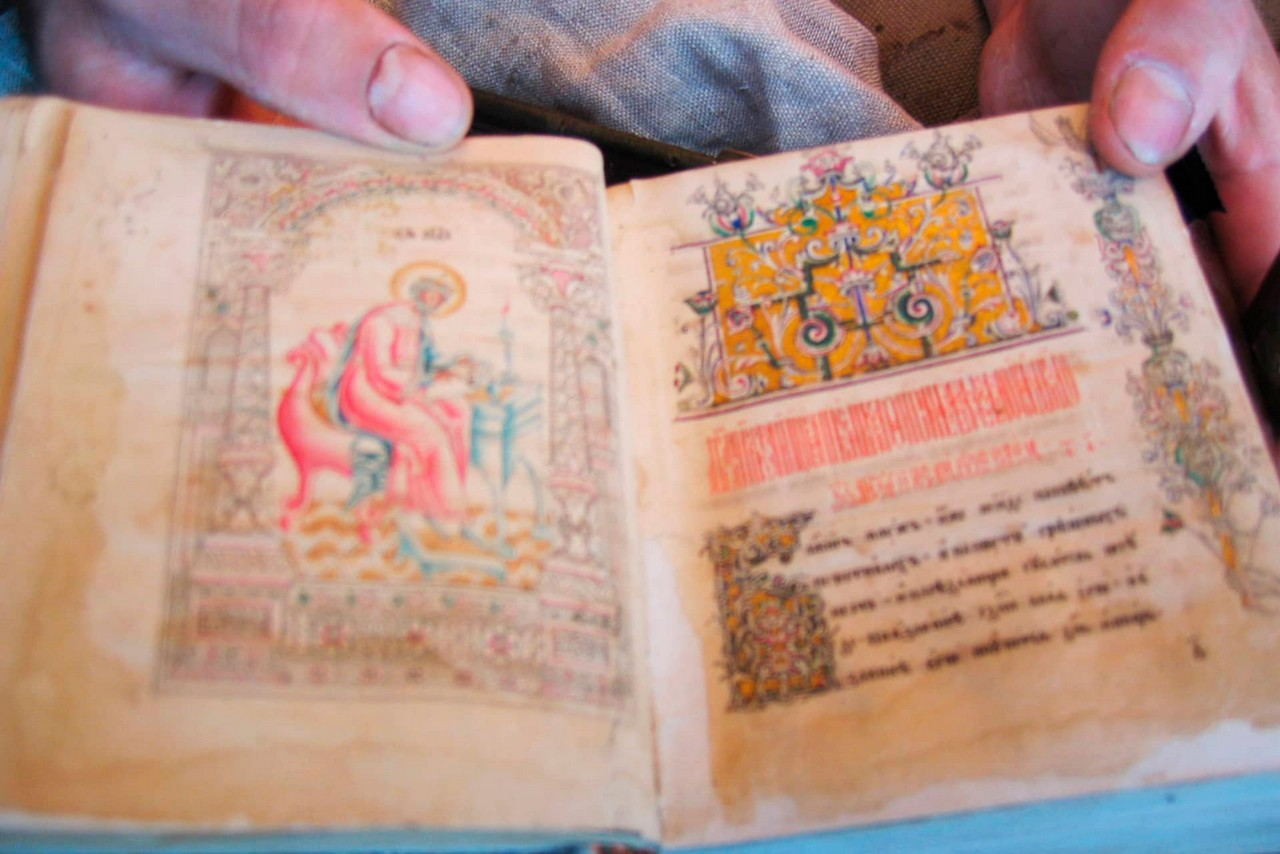 An open sacred old-believers' book with pictures of Saints