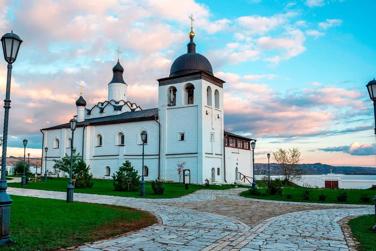 A white Orthodox church with three domes