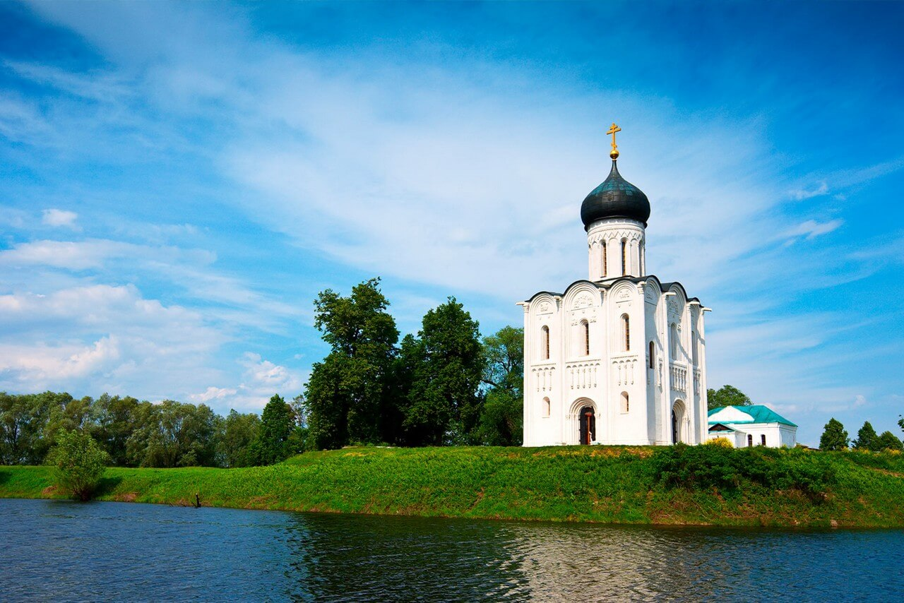 A little white church on a bank of the river.