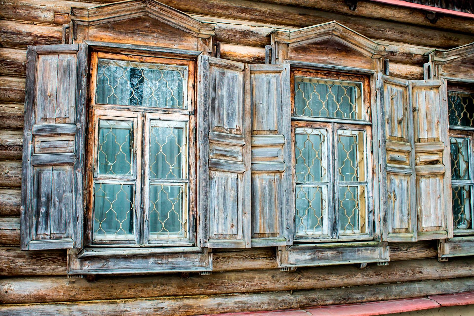 Two windows of a wooden house