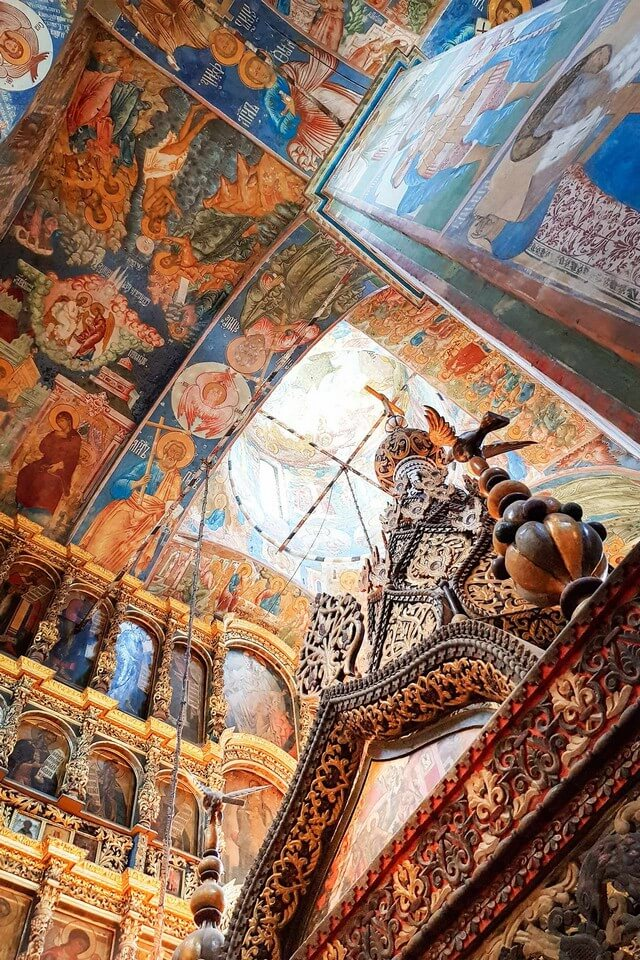 Interior of an Orthodox church decorated with impressive colorful fresco paintings