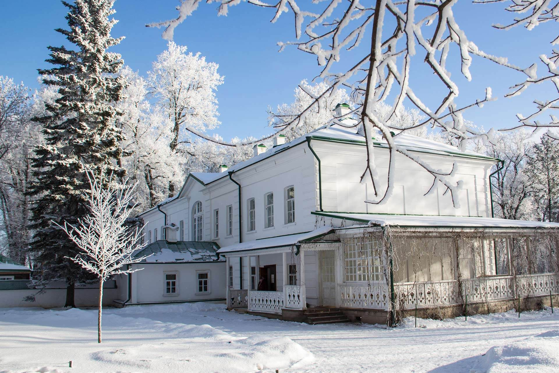 A white two-story mansion in winter