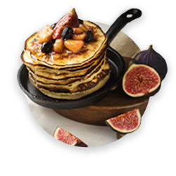 Small thick pancakes prepared on kefir and decorated with fruits
