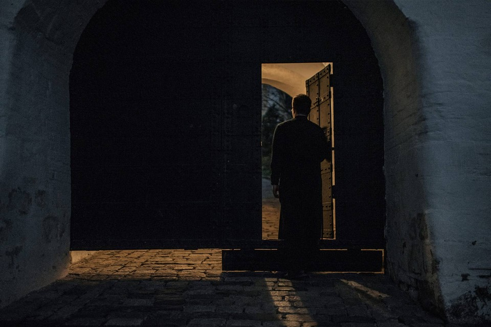 Orthodox monk entering the gates of a monastery