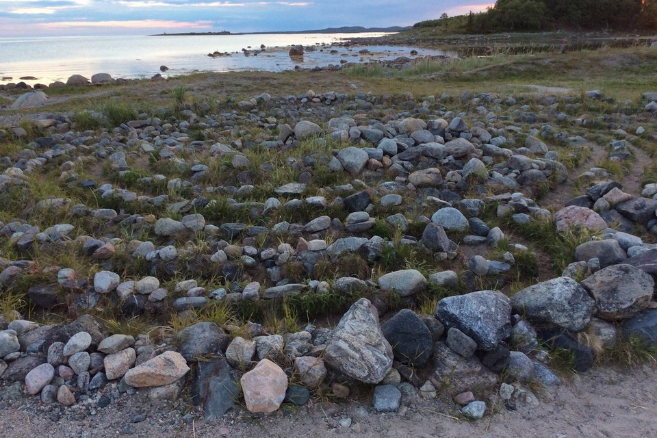 Spiritual stone labyrinth: heaps of boulders placed in the form of spiral made of several rows of stones