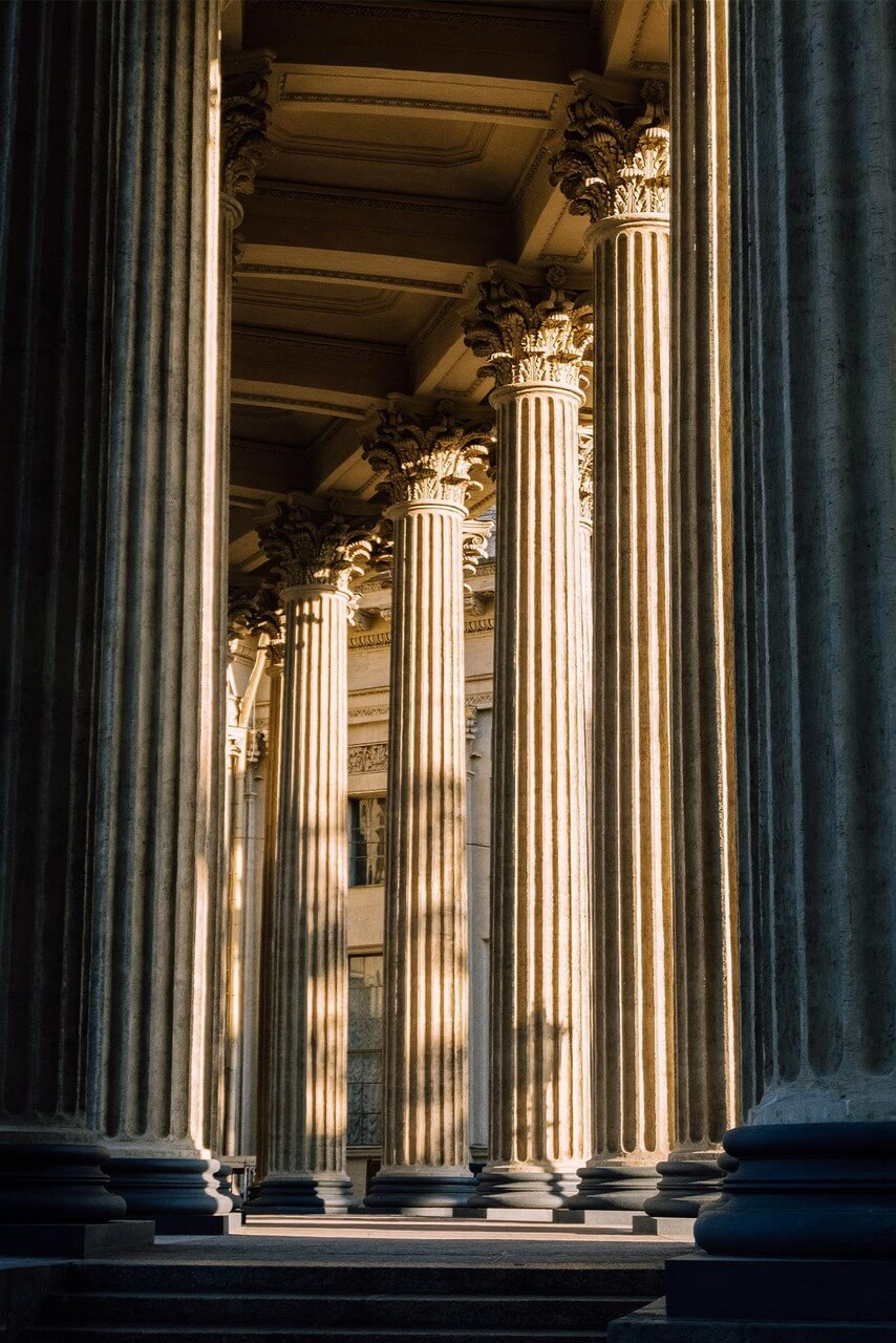 Giant columns of the half-round colonnade decorating the side facade of the cathedral