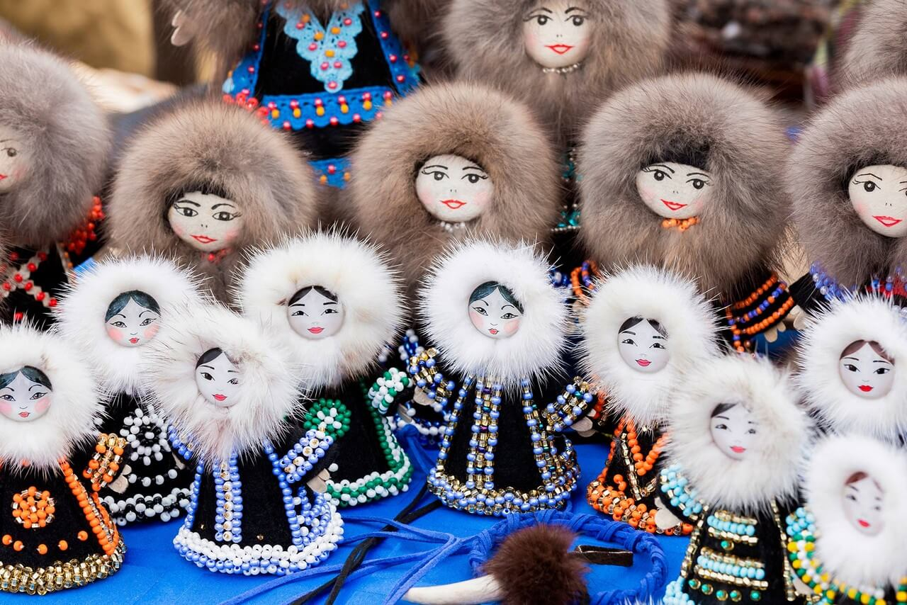 Yakut handmade dolls dressed in fur coats decorated with glass beads