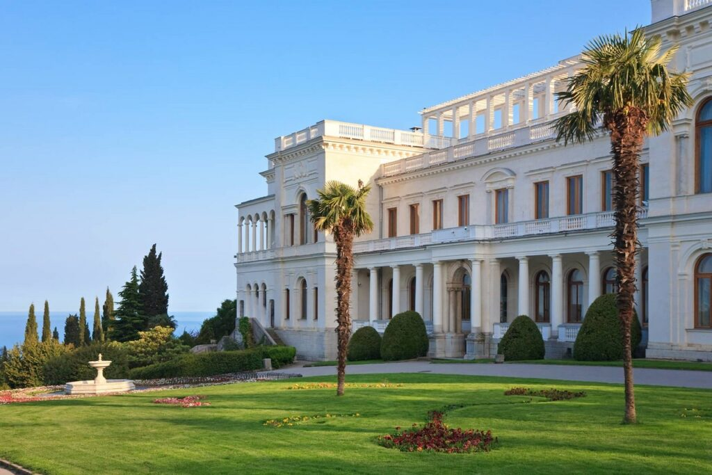 The palace built of white Crimean limestone in the Neo-Renaissance style, palace in Italian style with portico, a garden with a fountain in front of the palace