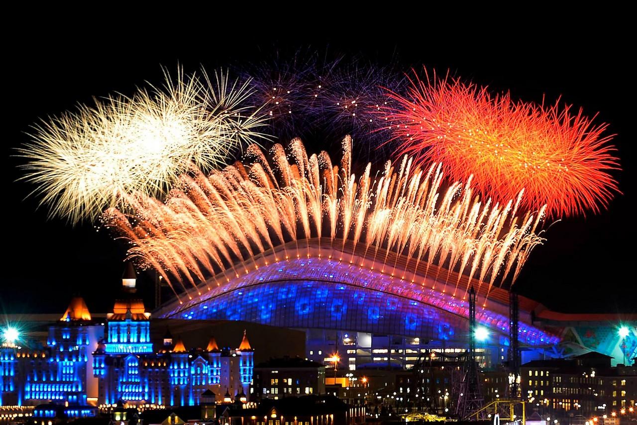 Fireworks display over a Stadium at night, stadium of unusual shape