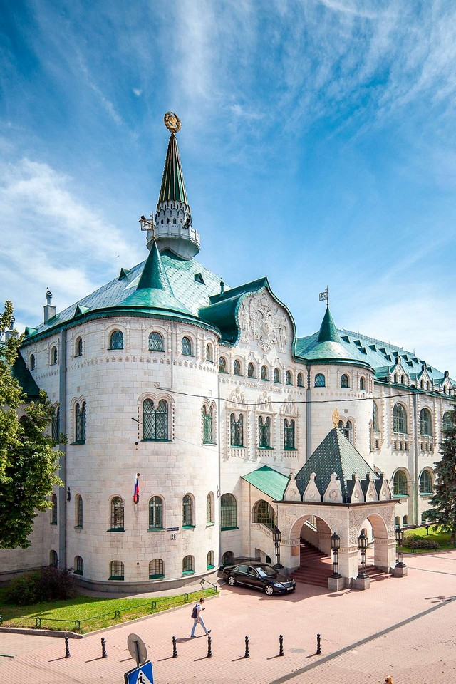 A building in neo-Russian style looking like a castle with green roof and towers in Bolshaya Pokrovskaya street