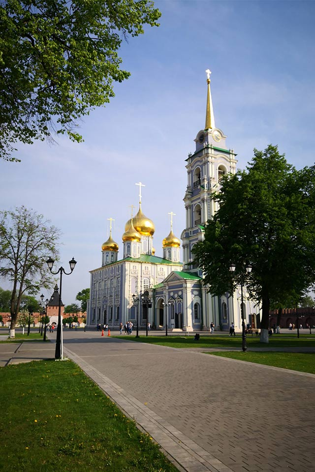 An Orthodox cathedral with gilded domes and a bell tower