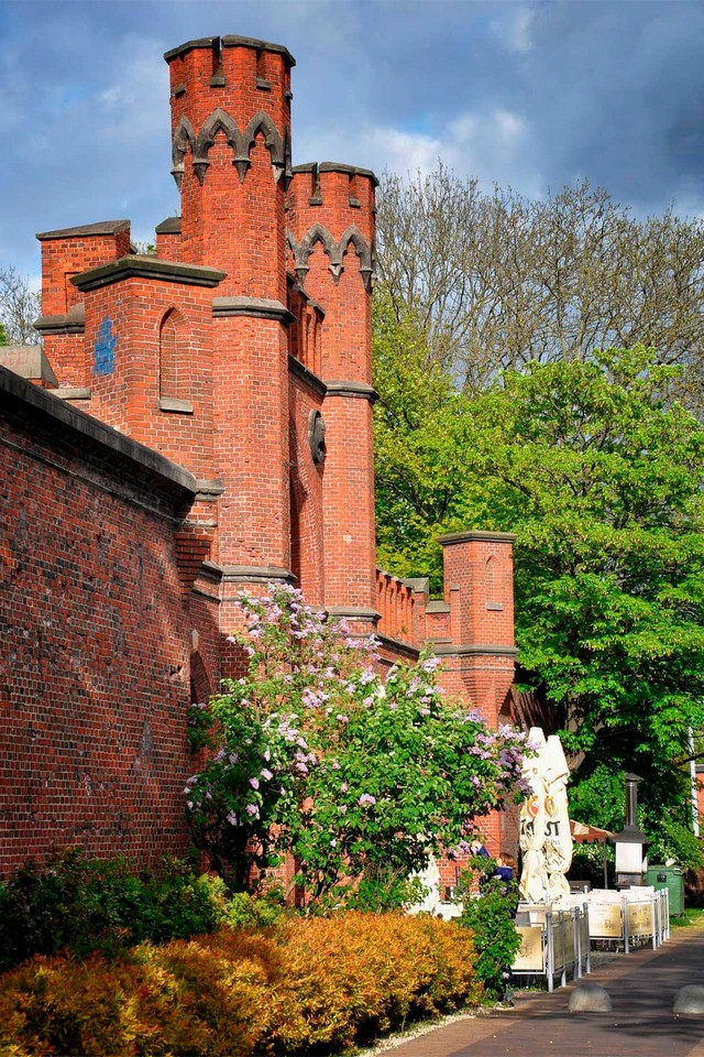 A medieval red brick building looking like a fortress