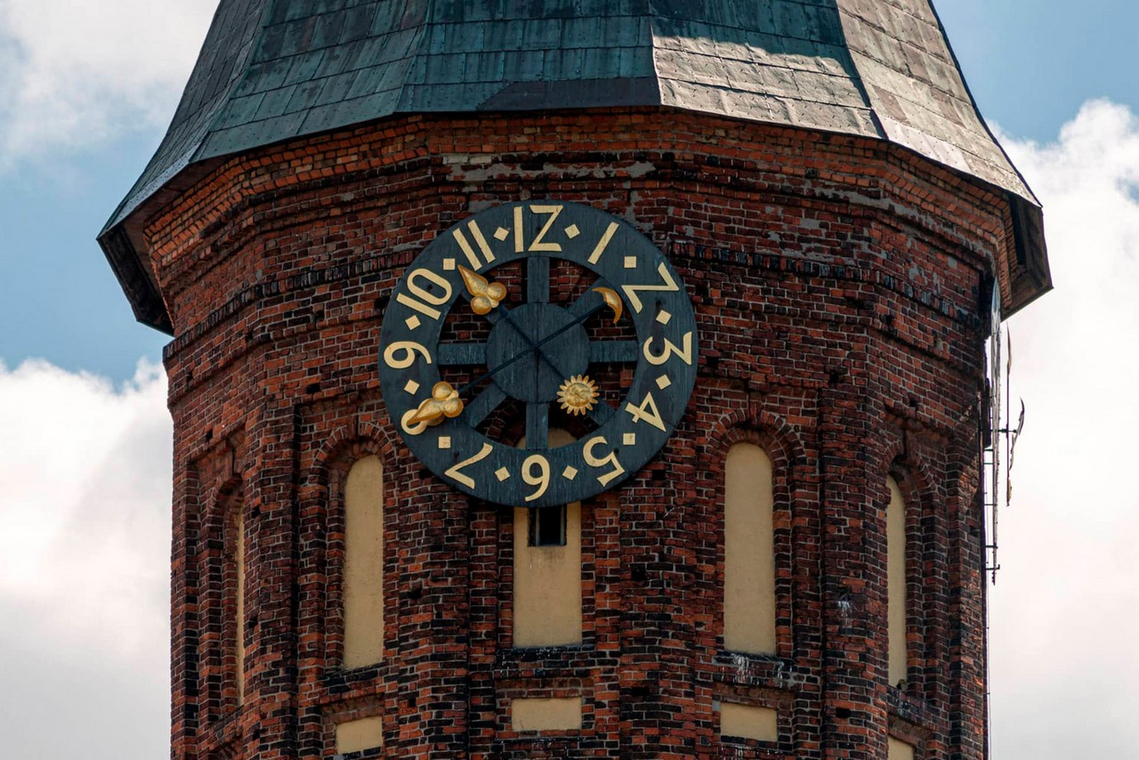 The clock on a red brick tower