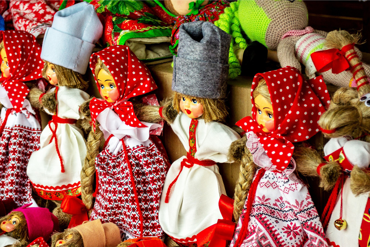Dolls with faces made of wood and handmade dresses