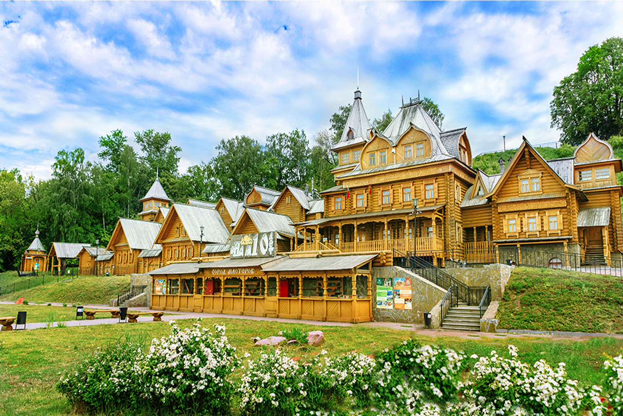 A big wooden building looking like a palace with rich wooden decorations