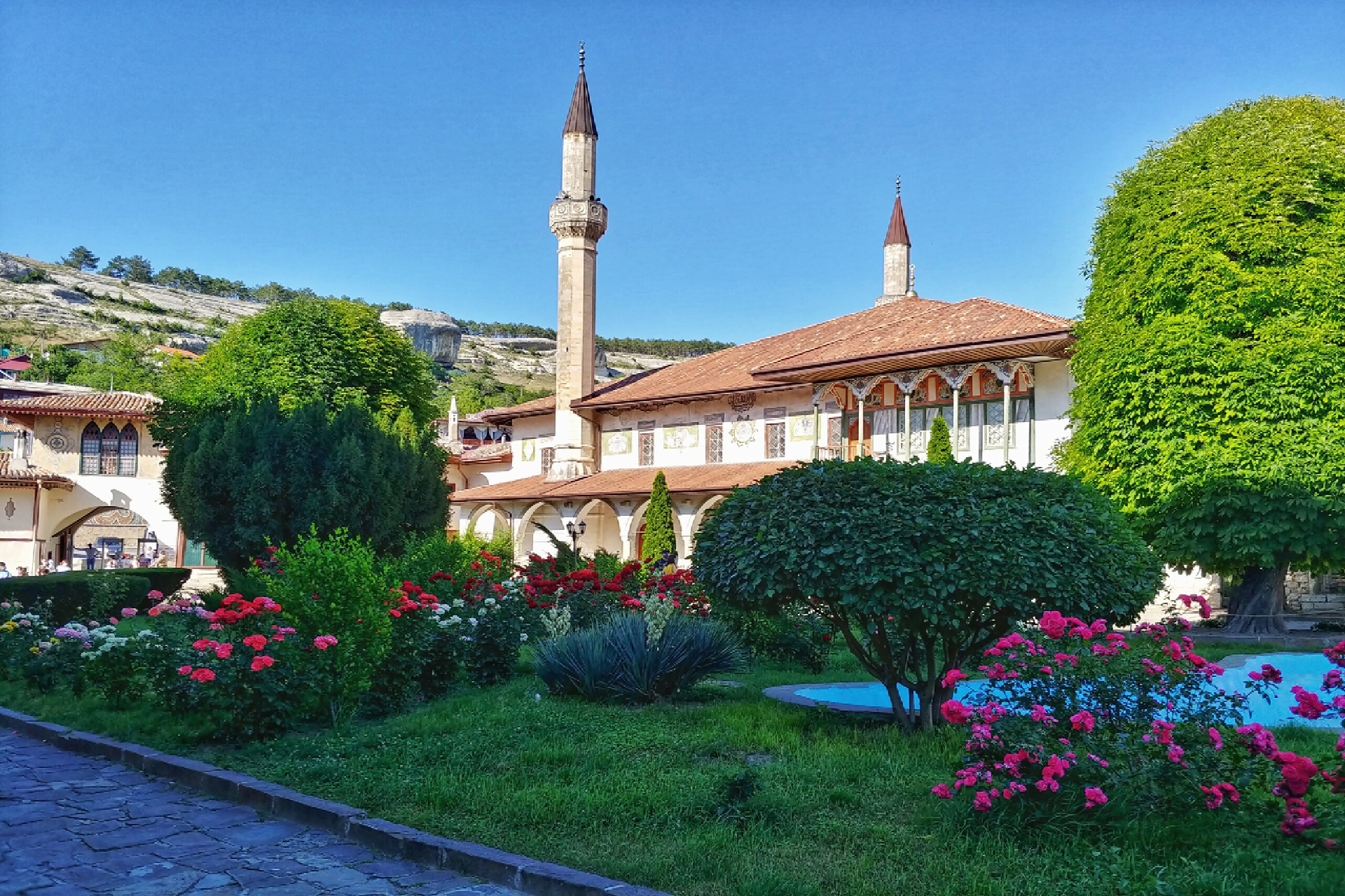 A palace in Arabic style with two minarets in a beautiful area with rocks and a park, the residence of the Crimean Tatar Khans