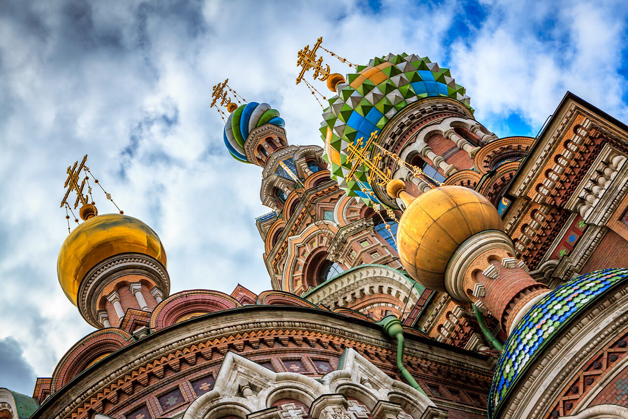 View of the top of a colorful cathedral from the ground. Colorful domes of a cathedral