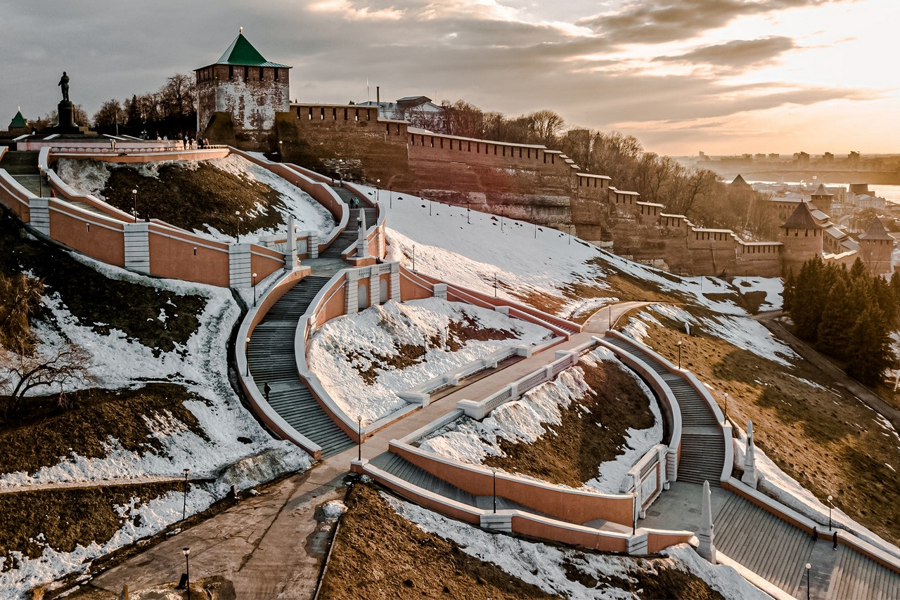 A redbrick wall of Kremlin and a flight of stairs in winter