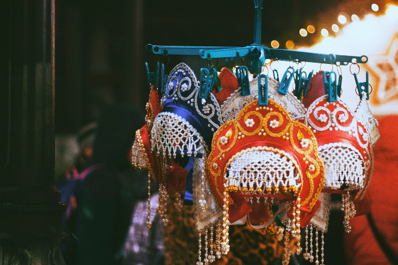 Kokoshniks (head-bands) of blue and red colors decorated with pearls in a souvenir shop