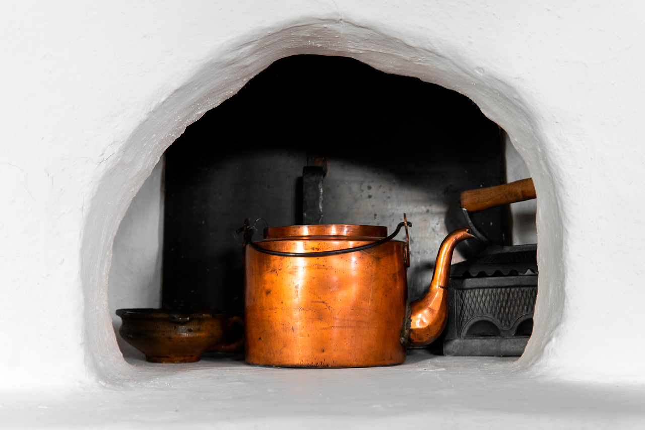 An old copper teapot, an old cast iron in a Russian stove