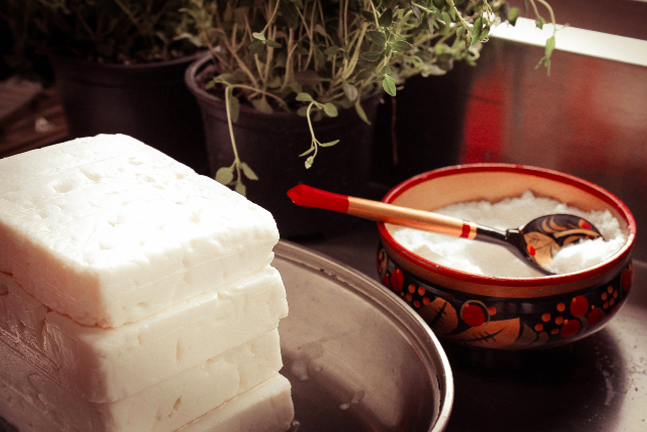 Homemade cheese, pieces of Russian wooden tableware on the table
