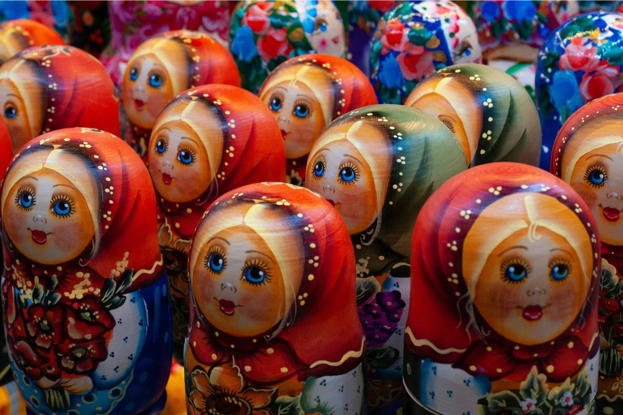 Many colorful Russian dolls with similar faces, traditional hand painted Russian dolls