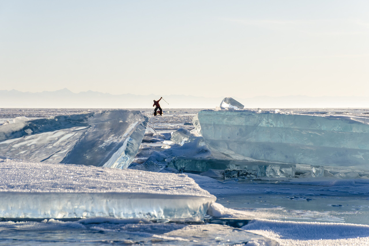 A man on the frozen lake surface