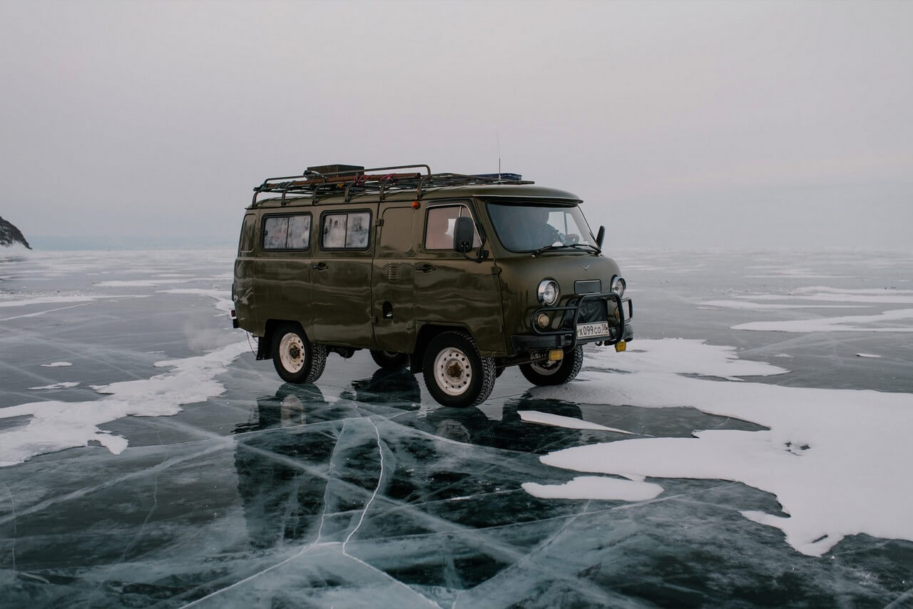 An off-road van on the ice of a lake