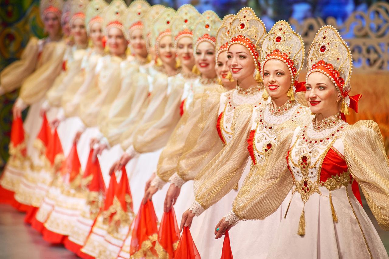 A Russian folk dance ensemble, women wearing traditional Russian clothes and kokoshniks
