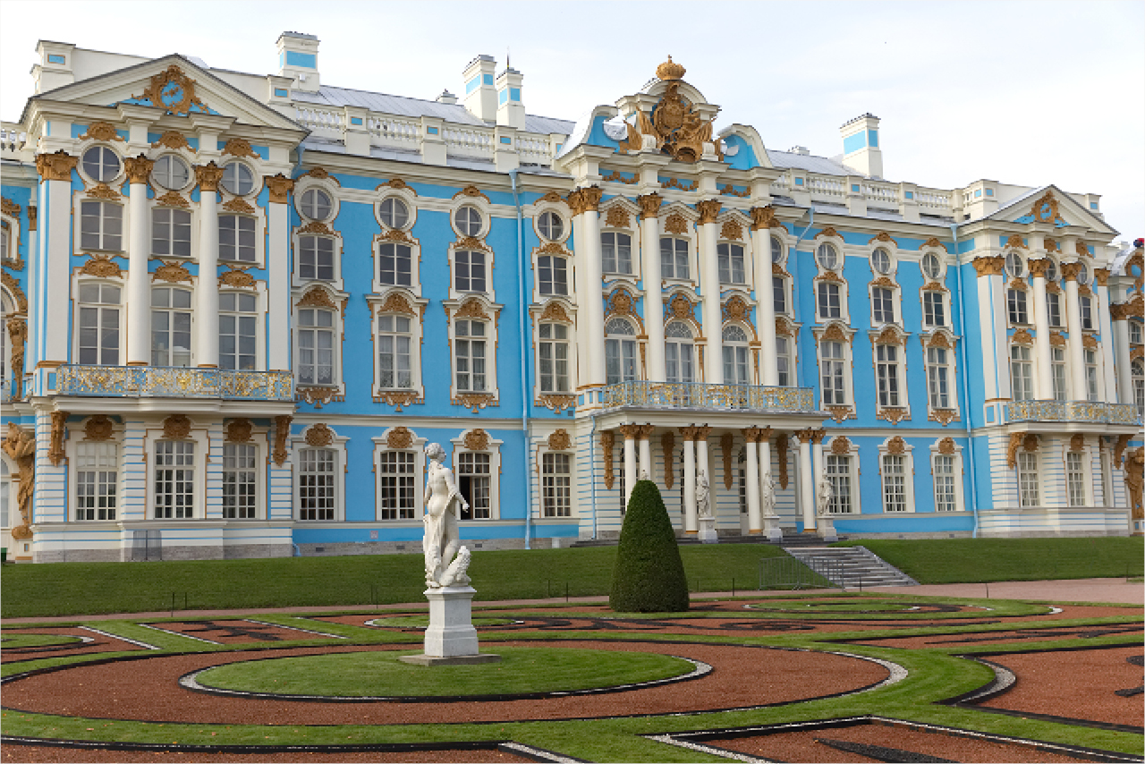 A beautiful blue and white royal palace in baroque style, façade of a palace decorated with a classical colonnade, stucco molding and gilded elements, decorative statues of mythic heroes on the facade