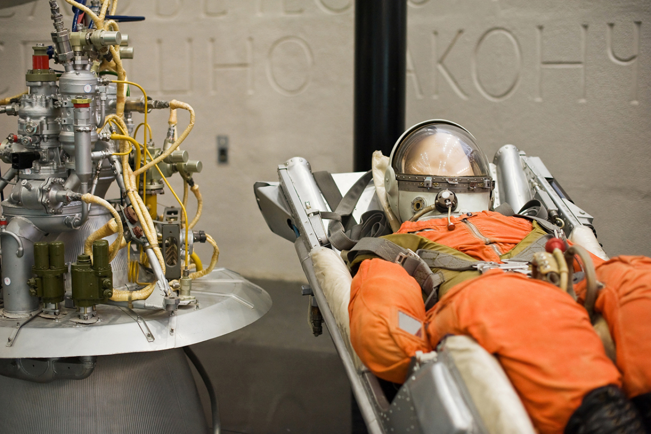 A costume of a soviet cosmonaut in an armchair, some mechanisms
